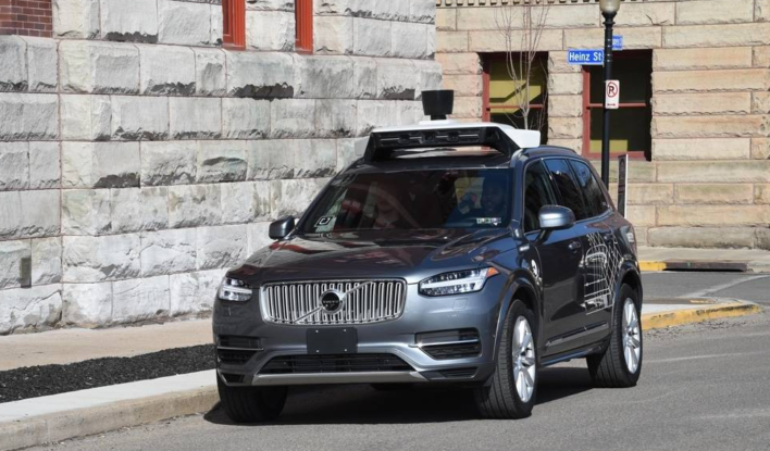 Uber halts self-driving car tests after death in Arizona